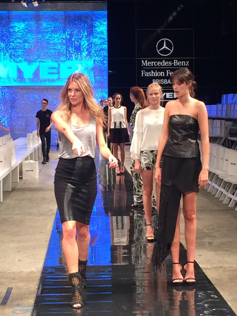 Jen Hawkins walk-through sharing catwalk with wide eyed models
